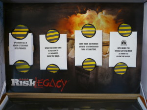 Risk Legacy shelters new players from advanced rules in a thematic way that actually adds to the fun of the game. Image from Thoughts from the Game Room.