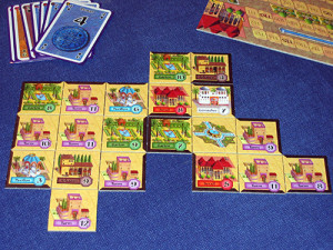 In Alhambra, players score points by having the most buildings of various colors. Image from Board Game Geek.